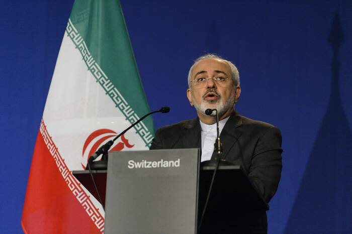 """Iranian Foreign Minister Mohammad Javad Zarif called it a """"win-win outcome."""" Later he tweeted """"There is no need to spin using 'fact sheets' so early on,"""" in a reference to a public document released by the United States listing both sides' commitments. (Source: AP)"""