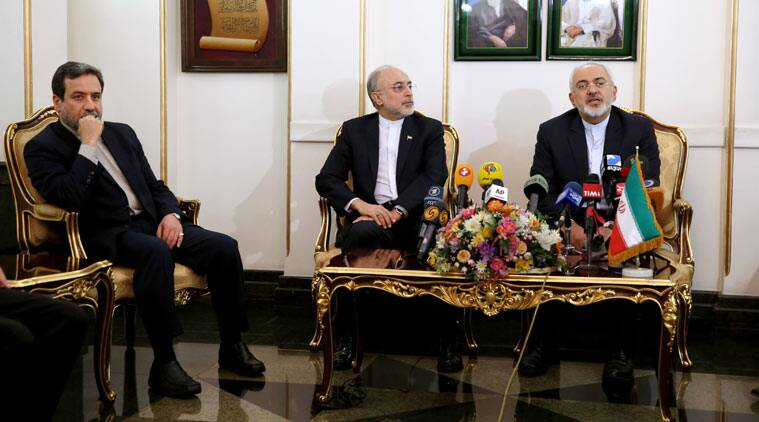 Iranian Foreign Minister Mohammad Javad Zarif, right, who is also Iran's top nuclear negotiator, speaks with media, as head of Iran's Atomic Energy Organization Ali Akbar Salehi, center, and deputy Foreign Minister Abbas Araghchi listen upon their arrival at the Mehrabad airport in Tehran, Iran, from Lausanne, Switzerland, Friday, April 3, 2015. (Source: AP photo)