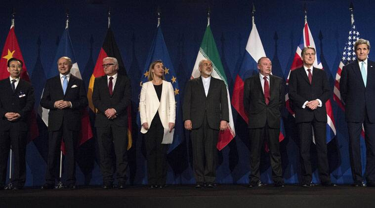 From left, Head of Mission of People's Republic of China to the European Union Hailong Wu, French Foreign Minister Laurent Fabius, German Foreign Minister Frank Walter Steinmeier, European Union High Representative Federica Mogherini, Iranian Foreign Minister Javad Zarifat, Russian Deputy Political Director Alexey Karpov, British Foreign Secretary Philip Hammond and US Secretary of State John Kerry arrive,  at the Swiss Federal Institute of Technology, or Ecole Polytechnique Federale De Lausanne,  in Lausanne, Switzerland, Thursday, April 2, 2015, after Iran nuclear program talks finished with extended sessions. (AP Photo)