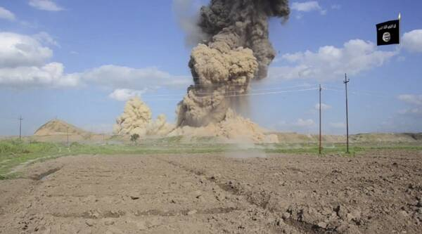 In this image made from video posted on a militant social media account affiliated with the Islamic State group late Saturday, April 11, 2015, purports to show militants destroying the ancient Iraqi Assyrian city of Nimrud, a site dating back to the 13th century B.C., near the militant-held city of Mosul, Iraq. (AP Photo)