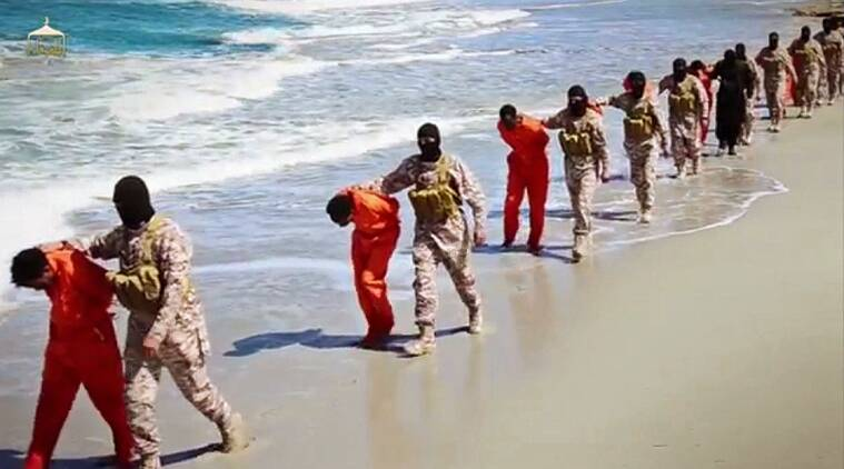This undated image made from a video released by Islamic State militants, Sunday, April 19, 2015, appears to show the killing of a group of captured Ethiopian Christians in Libya. (AP Photo)