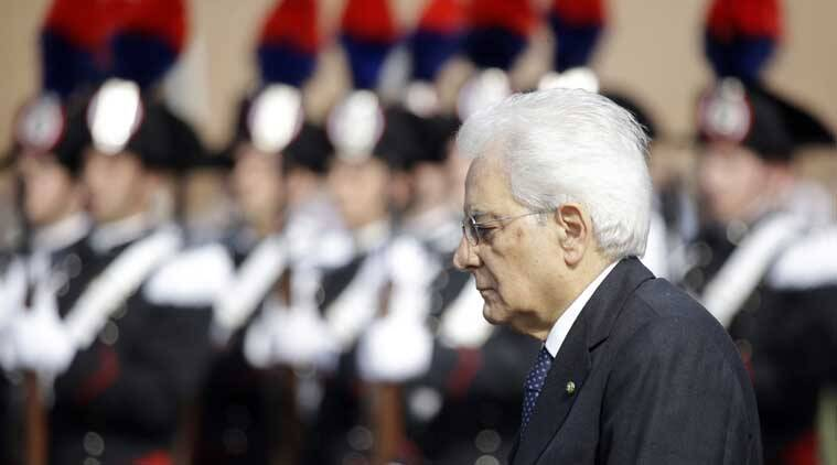 Italian President Sergio Mattarella reviews the honor guard during a ceremony to mark Italy's Liberation day, in Rome Saturday, April 25, 2015. (AP Photo)
