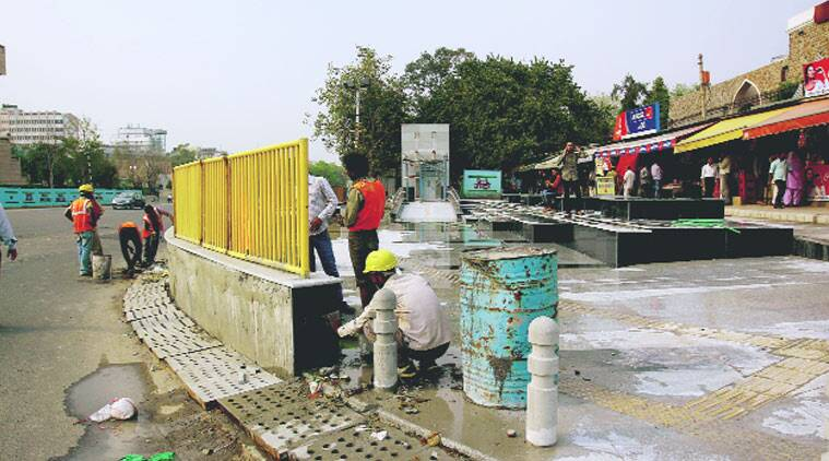 Workers give final touches to the ITO Metro station.PRAVEEN KHANNA