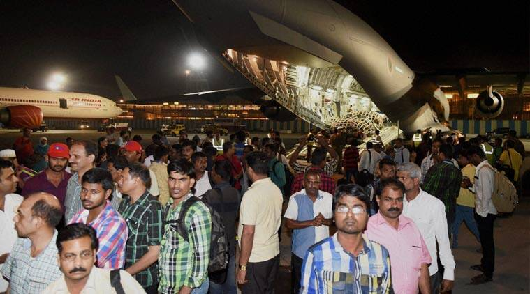 Earlier, 190 Indians alight from the Indian Air Force C 17 (Globemaster) aircraft after being evacuated from Djibouti, at the International Airport in Mumbai on early Thursday morning. (Source: AP)