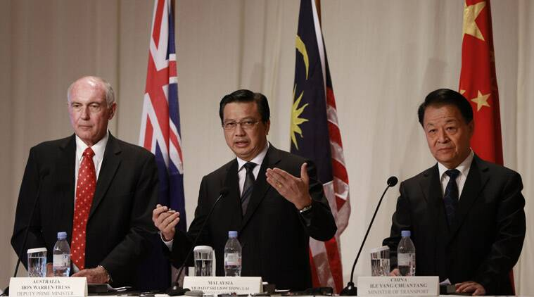 """Malaysian Transport Minister Liow Tiong Lai, center, speaks as Australian Deputy Prime Minister Warren Truss, left, and Chinese Minister of Transport Yang Chuantang listen during a press conference following their meeting in Kuala Lumpur, Malaysia, Thursday, April 16, 2015. The search area for the missing Malaysia Airlines Flight 370 will be expanded by another 60,000 square kilometers (23,000 square miles) in the Indian Ocean if the jetliner is not found by May, officials said Thursday. Liow told reporters that the three countries, which are leading the hunt for the Boeing 777 that went missing on March 8 last year, are """"committed to the search."""" (AP Photo/Vincent Thian)"""