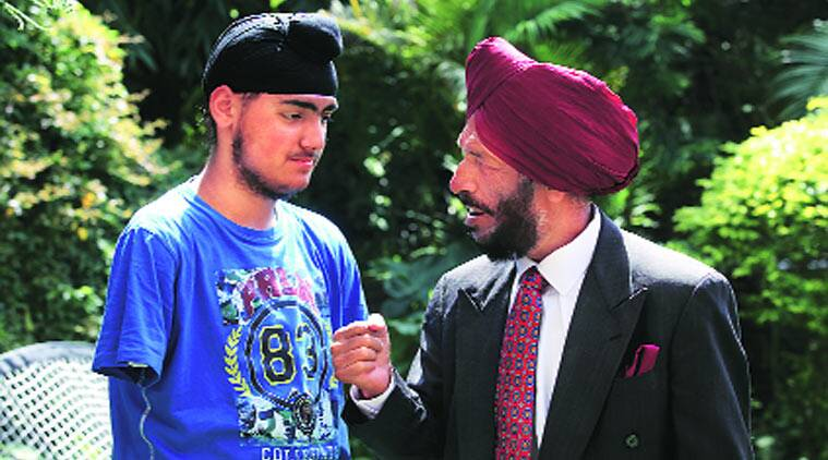 """Himmat Na Hari Kaka"": Milkha Singh with Chandeep Singh at their residence in Chandigarh on Thursday. (Source: express photo byJasbir Malhi)"