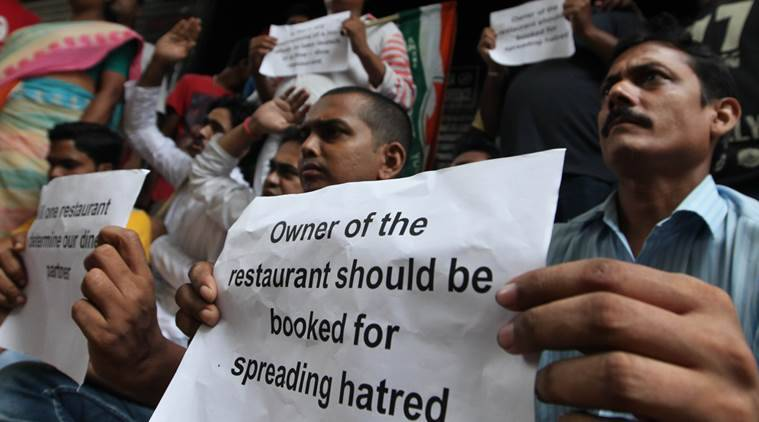 Youth congress members shouting slogans against the authority of Mocambo one of the renowned restaurant in Park Street Kolkata. Protester protests  in connection with (allegedly) restricted entry  to serve a women and her driver on September 09. demands arrest of restaurant authority and cancelled the licence , on September 13, 2016. Express photo by Partha Paul.
