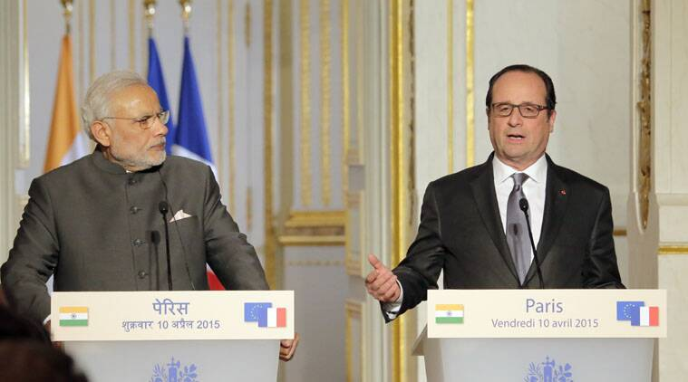 Indian Prime Minister Narendra Modi, left,  with French President Francois Hollande  attend a joint press conference at the Elysee Palace, in Paris, France, Friday, April 10, 2015, as part of a European tour for the Indian leader.  French authorities are hoping to build up already-strong contacts with the fast-growing Asian nation amid talks about a possible big fighter-jet deal. (AP Photo/Jacques Brinon)