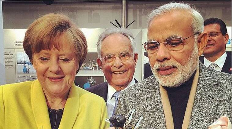 German Chancellor Angela Merkel with Prime Minister Narendra Modi marvelling at the wonders of technology in Hannover, Germany. (Source: Narendra Modi Instagram)