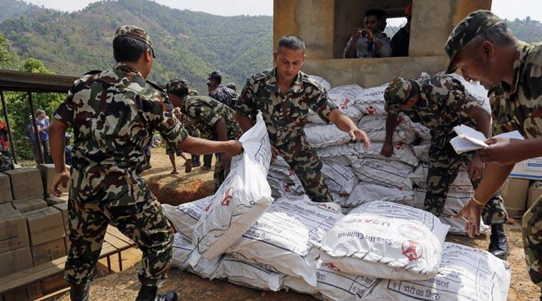 Nepalese soldiers load U.S. AID relief sacks at landing zone near Saturday's massive earthquake's epicenter in the town of Gorkha, Nepal, Tuesday, April 28, 2015. Preparing to make a push into the most isolated parts of quake-devastated Nepal, soldiers on Tuesday were readying food, water and other emergency supplies to be loaded onto helicopters in this small town near the earthquake's epicenter. (AP Photo/Wally Santana)