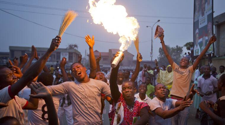 Supporters of opposition candidate Muhammadu Buhari celebrate an anticipated win for their candidate, in Kano, Nigeria Tuesday, March 31, 2015. Nigeria's aviation minister says President Goodluck Jonathan has called challenger Muhammadu Buhari to concede and congratulate him on his electoral victory, paving the way for a peaceful transfer of power in Africa's richest and most populous nation. (AP Photo/Ben Curtis)