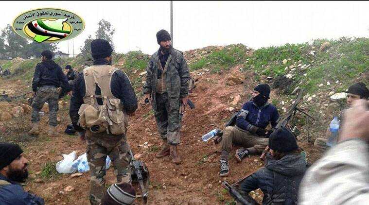 FILE - In this Sunday, Dec. 14, 2014 file photo provided by the anti-government activist group Syrian Observatory for Human Rights, which has been authenticated based on its contents and other AP reporting, shows Jihadi fighters from the al-Qaida-linked Nusra Front and other rebel factions, rest after clashes with Syrian troops in Wadi Deif in the northwestern province of Idlib, Syria. The Nusra Front, Syria's al-Qaida affiliate, is consolidating power in territory stretching from the Turkish border to central and southern Syria, crushing moderate opponents and forcibly converting minorities using tactics akin to its ultraconservative rival, the Islamic State group. (AP Photo/Syrian Observatory for Human Rights, File)