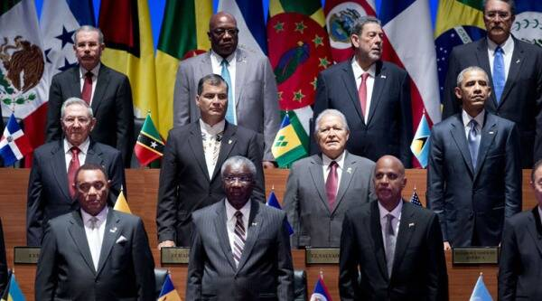U.S. President Barack Obama, right middle row, and Cuban President Raul Castro, left middle row, and other world Leaders participates in the inauguration ceremony of the Summit of the Americas arrival ceremony in Panama City, Panama, Friday, April 10, 2015. (AP Photo)