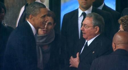 U.S. President Barack Obama (L) shakes hands with Cuban President Raul Castro (C) in this still image taken from video courtesy of the South Africa Broadcasting Corporation (SABC) at the First National Bank (FNB) Stadium, also known as Soccer City, during former South African President Nelson Mandela's national memorial service in Johannesburg December 10, 2013. Obama shook the hand of Castro at a memorial to Nelson Mandela. (Reuters)