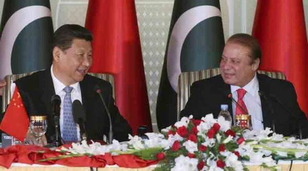In this April 20, 2015 photo released by China's Xinhua News Agency, visiting Chinese President Xi Jinping, left and Pakistan's Prime Minister Nawaz Sharif attend a press conference after their talks in Islamabad, Pakistan. Xi is on a two-day visit in which he is expected to announce  billion worth of investment projects in energy and infrastructure development. (Lan Hongguang)