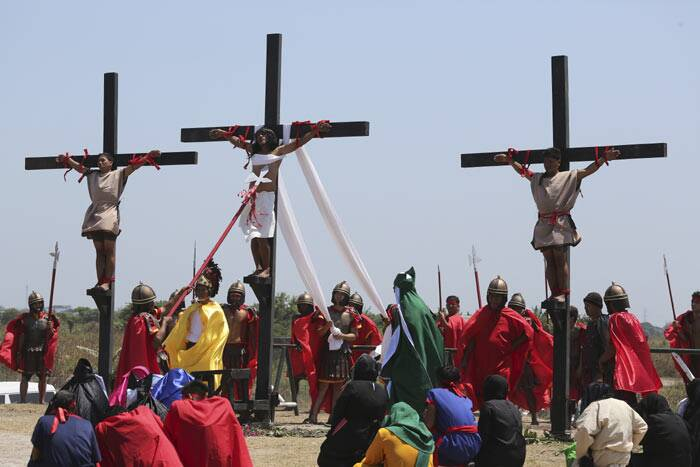 Church members carry crosses through Savannah on Good Friday