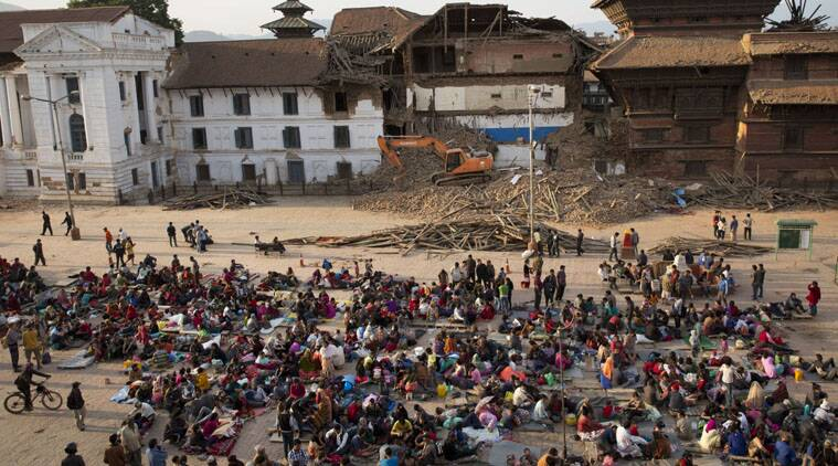 People gather on an open space for security reasons at the Basantapur Durbar Square, damaged in Saturday's earthquake in Kathmandu, Nepal, Sunday, April 26, 2015.  (AP Photo)