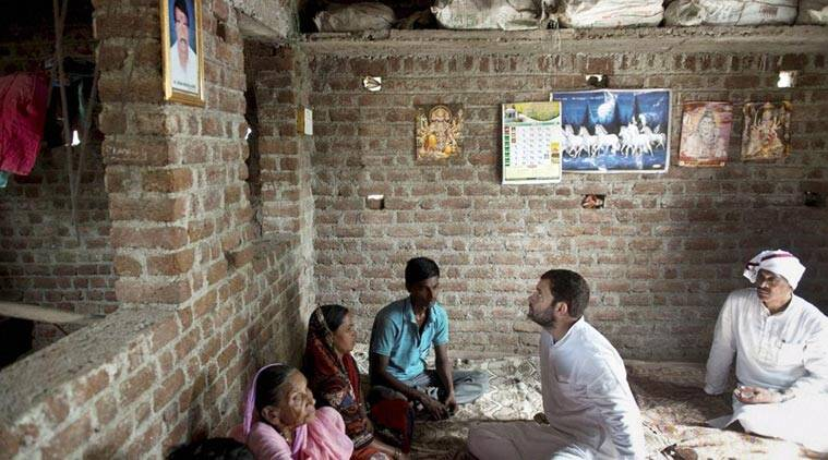 Congress vice-president Rahul Gandhi meeting family members of a farmer who committed suicide, during his 15-km padyatra in Amravati district in Vidarbha region of Maharashtra on Thursday. (Source: PTI)