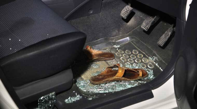 In this picture taken late Friday, April 24, 2015, sandals lie on the floor of a car surrounded by broken glass in the damaged car of a prominent women's rights activist Sabeen Mehmud following an attack on Mehmud in Karachi, Pakistan.