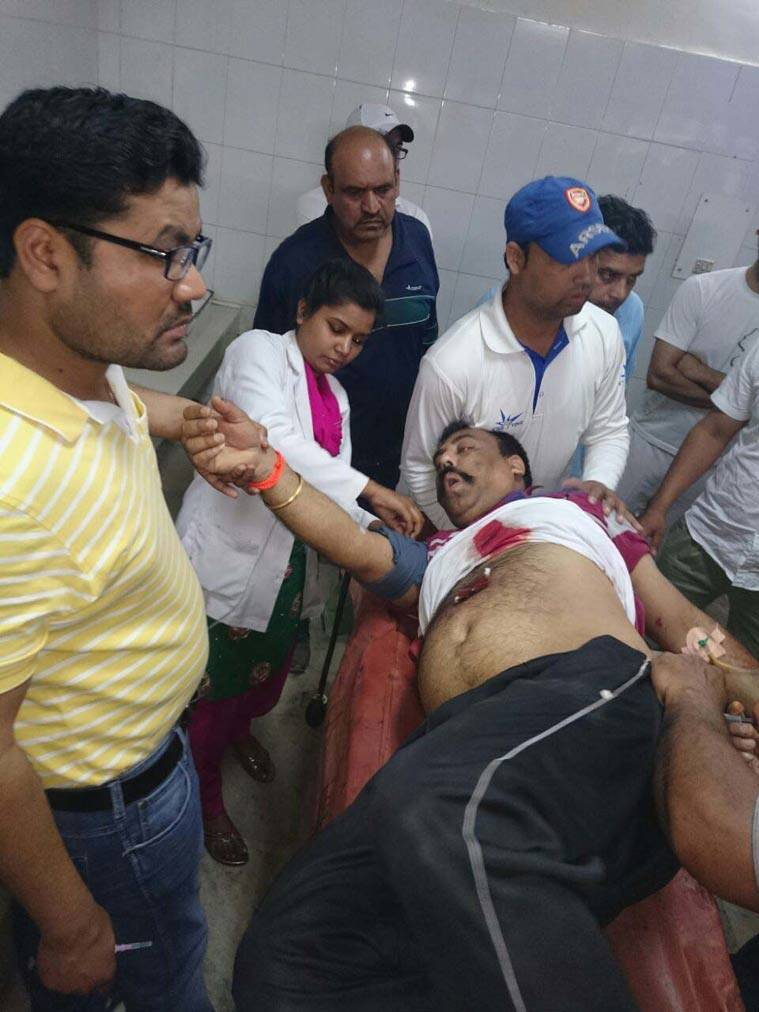 Punjab Shiv Sena leader Harvinder Soni at a hospital in Gurdaspur before he was taken to Amritsar for treatment. (Source: Express photo)