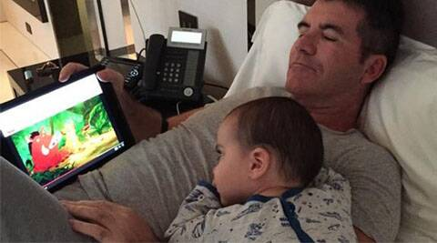 Simon Cowell, baby son eric, Simon Cowell eric cuddle, simon son eric cuddle on bed, simon cowell cuddles with son, simon cowell son picture, simon cowell with eric photo, simon cowell eric photo twitter, simon cowell baby eric snapshot, hollywood news, entertainment news