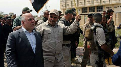 Iraqi Prime Minister Haider al-Abadi tours the city of Tikrit after it was retaken by the security forces in Baghdad, Iraq, Wednesday, April 1, 2015.