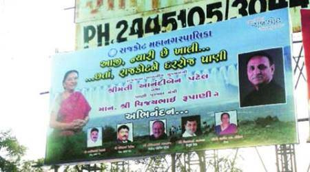 Rajkot hoarding, Narmada water, RMC, Anandiben Patel, Vijay Rupani, BJP, MLD, poll drive, drive for poll, Congress, ahmedabad news, nation news, india news, national news