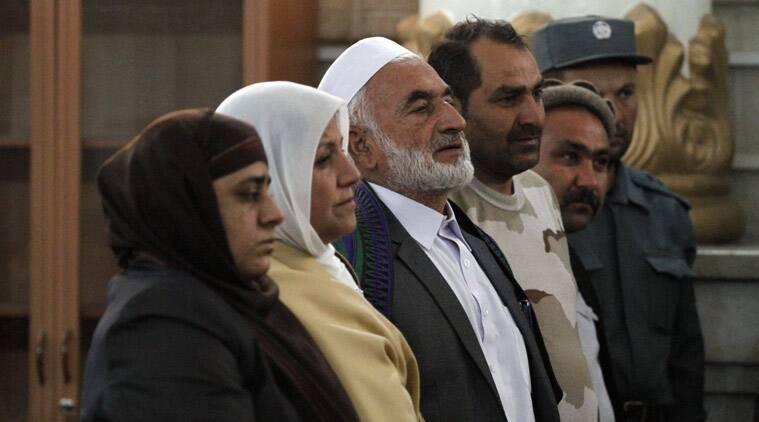 Relatives of a 27-year-old woman named Farkhunda, who was beaten to death by a mob, that was sparked by a bogus accusation that she had burned a copy of the Quran, attend a hearing at the Primary Court in Kabul, Afghanistan, Wednesday, May 6, 2015. The Afghan court on Wednesday convicted and sentenced four men to death for their role in the brutal mob killing in Kabul in March — a slaying that shocked the nation and spurred calls for authorities to ensure women's rights to equality and protection from violence. (AP Photo/Allauddin Khan)