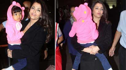 PHOTOS - Aishwarya Rai returns with Aaradhya to India from Cannes