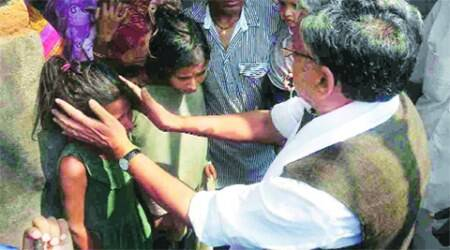 BJP leader Sushil Kumar Modi meets the family of Bharat Sharma, who committed suicide last week. (Source: Express photo)