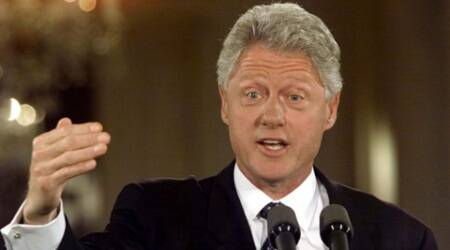 Former U.S. President Bill Clinton defends charity, says won't give up paid speeches