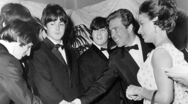 """Britain's Princess Margaret with Lord Snowdon, Anthony Armstrong Jones, 2nd left, as he shakes hands with Ringo Starr when meeting the Beatles before the world charity premiere of their second film, """"Help"""", at the London Pavilion, in London, England, on July 29, 1965. Paul McCartney, is centre left, and John Lennon, center right. (July 29, 1965 file photo - AP)"""