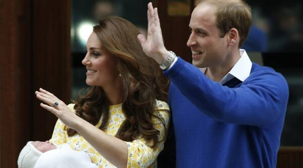 Britain's Prince William, right, and Kate, Duchess of Cambridge, pose for the media with their newborn daughter outside St. Mary's Hospital. (AP Photo)