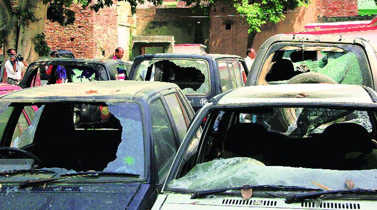 mob attack, mob violence, mob attacks sunday mass, cars vandalised, pune news, pune crime, indian express