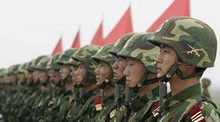 China elevates rank of military command along Indian border