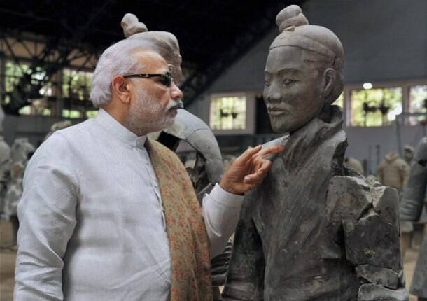 Modi in China, PM Modi, NArendra Modi, Modi China, Modi China tour, Modi china visit, Modi Xian, PM Modi in Xian, Xian terracotta museum, Modi in terracotta Museum, Modi in Daxingshan temple, India news, China news, Modi China Photos, PM Modi in china Photos