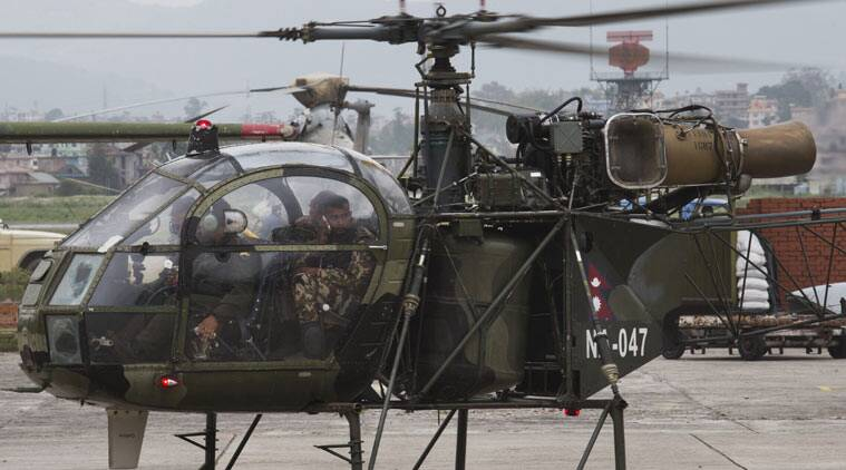 A Nepalese army chopper, that spotted the suspected wreckage of a U.S. Marine helicopter, lands at the airport in Kathmandu, Nepal, Friday. (Source: AP photo)