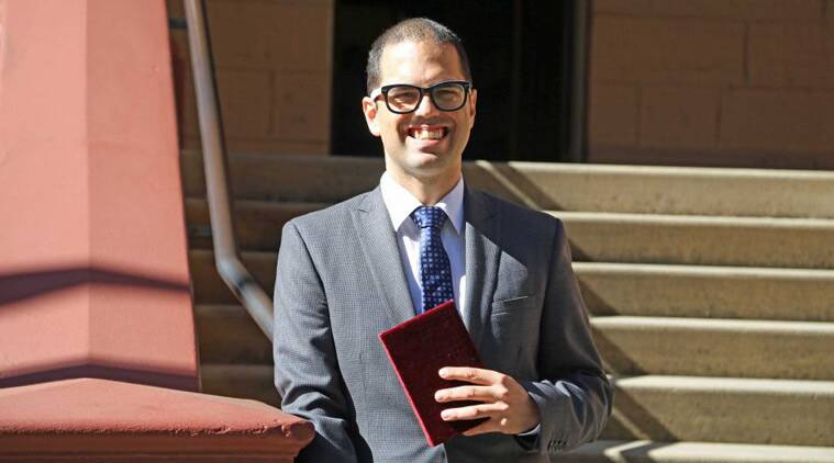 Daniel Mookhey with the Bhagavad-gita outside NSW Parliament. (SourceL NSW parliament)