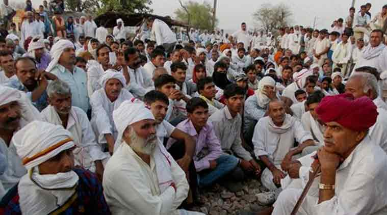 Bharatpur: Gujjar leader Kirori Singh Bainsla with his community people as they agitating to demand reservation in government jobs and educational institutions for their community on Delhi-Mumbai railway track near Bayana village in Bharatpur district of Rajasthan on Monday. (Source: PTI)