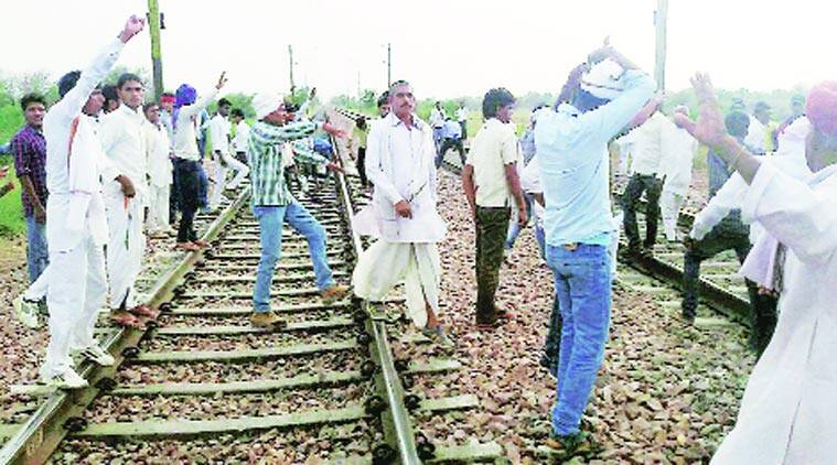 People of Gujjar community protest on the Delhi-Mumbai railway route in Rajasthan on Thursday.(Source: PTI)