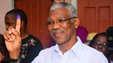 Presidential Candidate of the A Partnership for National Unity and Alliance For Change (APNU+AFC) David Granger displays his inked finger after voting at the Enterprise Primary School Georgetown Guyana, Monday, May 11, 2015. A party in power for over two decades in Guyana faced off in general elections Monday against a new coalition of opposition parties that seeks to challenge a tradition of racial politics and accuses the government of mismanagement and corruption. (AP Photo/Adrian Narine)