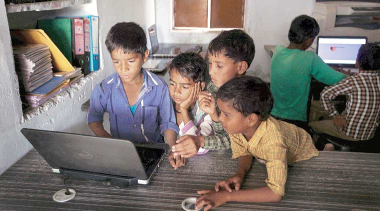 (Top) Children at the Internet centre in Chandauli say they are friends with Mark Zuckerberg on Facebook and translate his posts on Google Translate. (Source: Express photo by Oinam Anand)