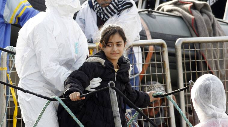 A girl is helped disembark from the Iceland Coast Guard vessel Tyr, at the Messina harbor, Sicily, southern Italy, Wednesday, May 6, 2015. This weekend saw a dramatic increase in rescues as smugglers in Libya took advantage of calm seas and warm weather to send thousands of would-be refugees out into the Mediterranean in overloaded rubber boats and fishing vessels. (AP Photo/Antonio Calanni)