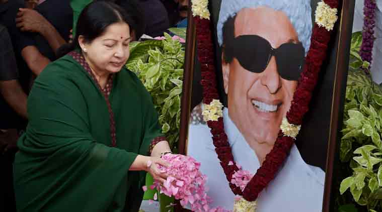 AIADMK General Secretary Jayalalithaa paying floral tribute at former chief minister and party founder MGR's statue in Chennai on Friday. (Source: PTI)