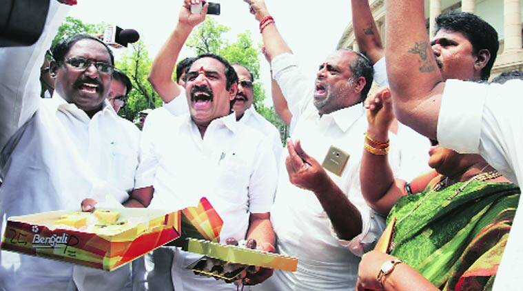 AIADMK MPs celebrate at the Parliament on Monday.(Express Photo by: Renuka Puri)