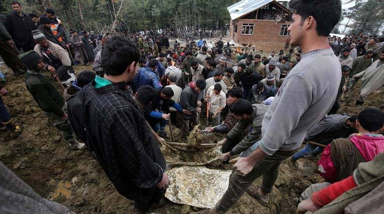 Kashmiri villagers and officials search for bodies following landslides due to heavy rainfall in the village of Laden at Chadoora. (Source: Express Photo by Shuaib Masoodi)