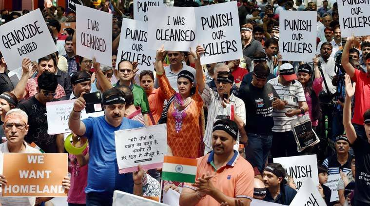 Kashmiri Pandits protest demanding their involvement before any decision on their return to the Valley, in New Delhi on Sunday. (Source: PTI)
