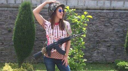 Lauren Gottlieb courts controversy for posing withrifle