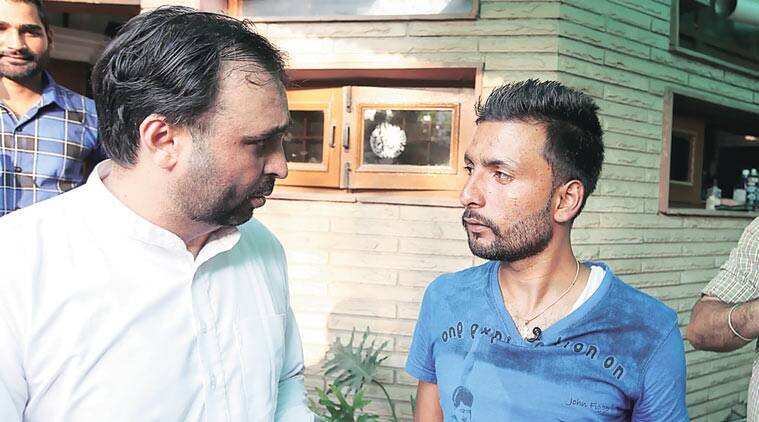 Masih with AAP MP Bhagwant Mann at the latter's Mohali house Thursday where they spoke to the media. (Source: Express Photo by Jasbir Malhi)