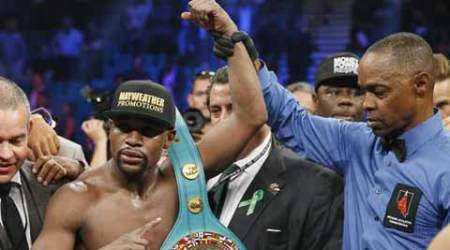 Floyd Mayweather vs Manny Pacquiao: Floyd Mayweather beats Manny Pacquiao by unanimous decision to remain undefeated